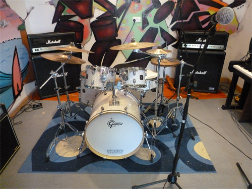 A photograph of drum and amp equipment available for use within The Base.