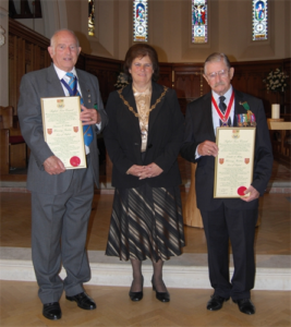 A photograph of Honorary Freemen Laurie Holland and Don Mabey MBE with the 2012 Seaford Town Council Mayor Linda Wallraven at the Freeman of the Town Ceremony