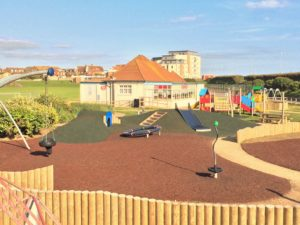 A photograph of the Salts recreation ground play area with cafe in background