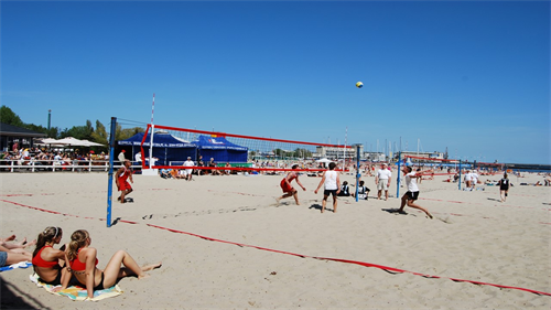 A photograph of a beach volly ball match