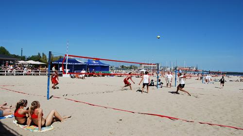 A photograph of a beach volly ball match