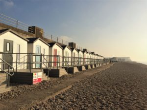 Photo of the outside of the Bonningstedt Beach Huts at sunset
