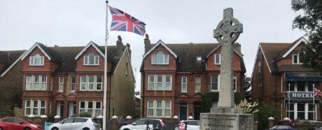 War memorial and flag