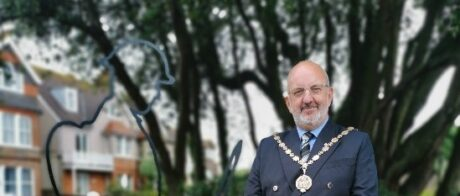 Photo of the 2020 Mayor of Seaford standing beside a war memorial