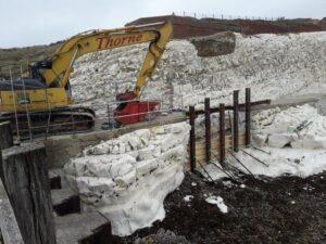 A photograph of a digger on site at Splash Point carrying out the repair works