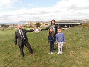The Mayor of Seaford standing on Seaford Head presenting the Don Mabey award