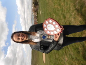 Clare Davis, President of the Seaford Chamber of Commerce holding the Don Mabey award shield