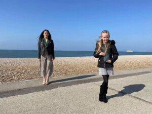 Young Mayor of Seaford and Young Mayor's awardee standing on Seaford Beach holding the award