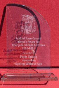 """A closer picture of the glass Mayor's Award engraved with the words """"Seaford Town Council Mayor's Award for Intergenerational Activities 2020-2021"""""""