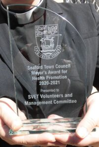 """A closer picture of the glass Mayor's Award engraved with the words """"Seaford Town Council Mayor's Award for Health Promotion 2020-2021"""""""