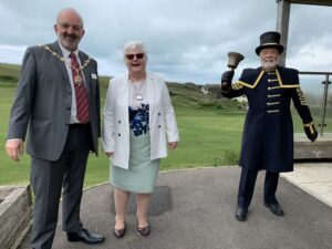 Picture of the Mayor and Mayoress together with the Town Crier