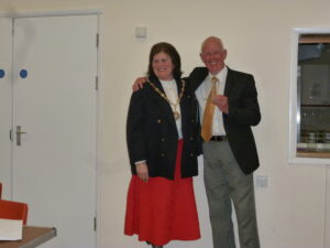 Jon Freeman (R) receiving his Mayor's Award from Past Mayor and current Town Councillor, Linda Wallraven (L)